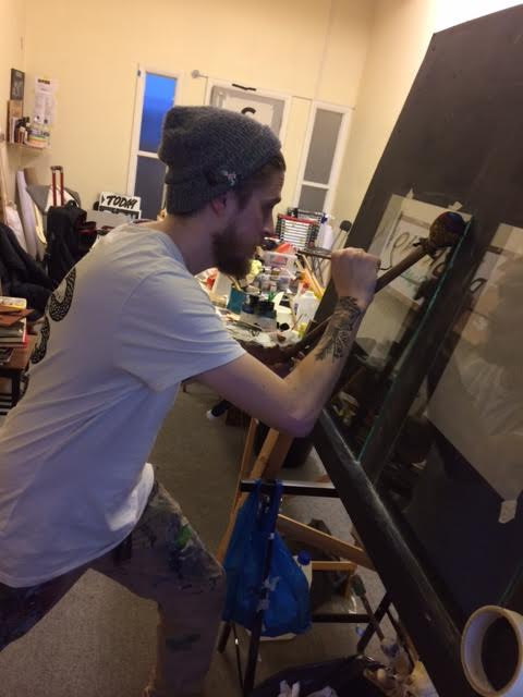 Joey Coleman learning to gild at NGS Signwriting Training Studio London